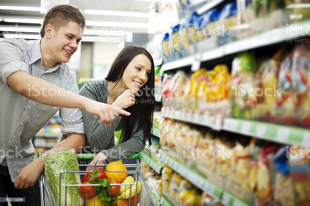 Couple at supermarket doing groceries royalty-free stock photo