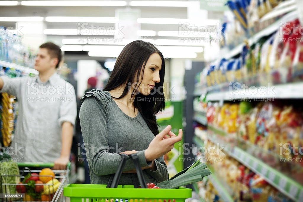 Couple at supermarket royalty-free stock photo
