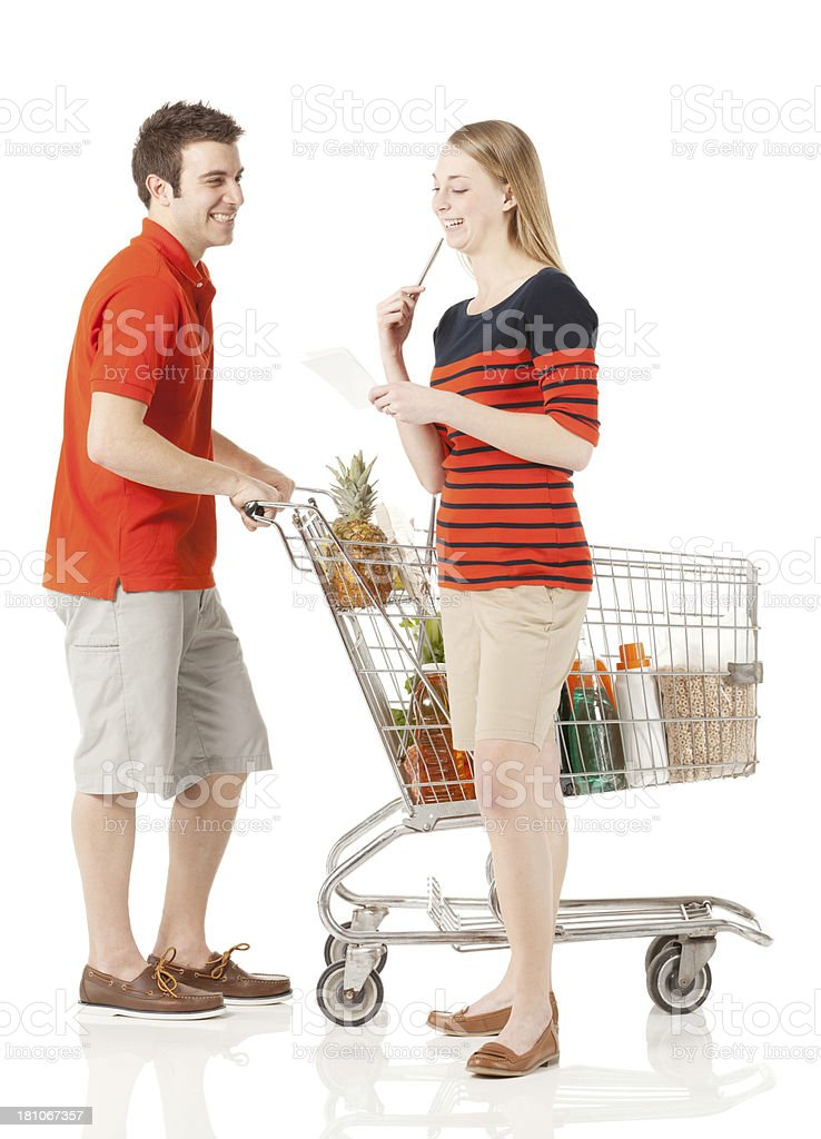Couple at supermarket with a shopping cart royalty-free stock photo