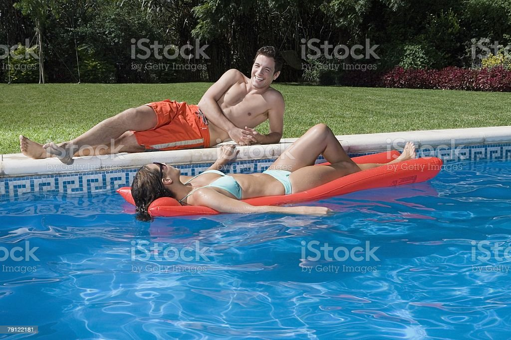 Couple at swimming pool royalty-free stock photo