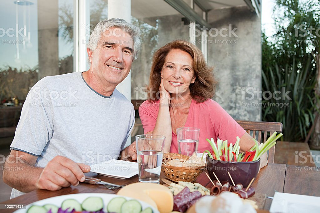 Couple at table outdoors royalty-free stock photo