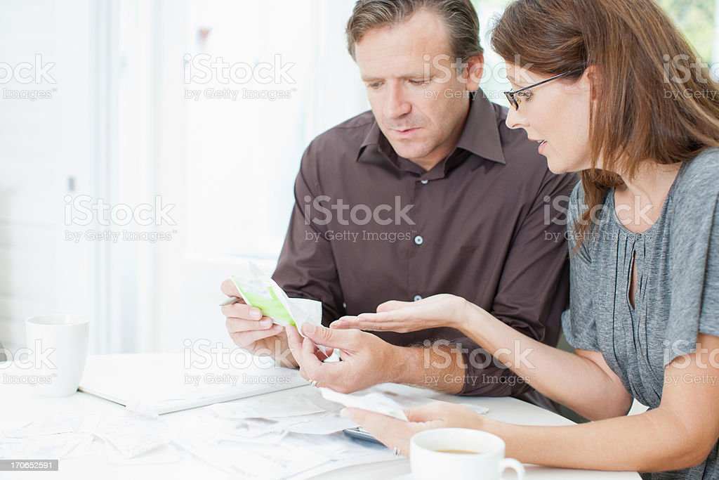 Couple at table paying bills royalty-free stock photo