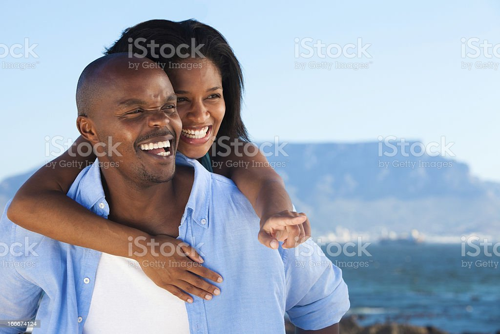 Couple at the beach enjoying view royalty-free stock photo