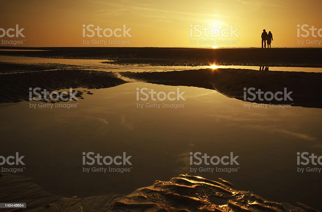 couple at the beach royalty-free stock photo