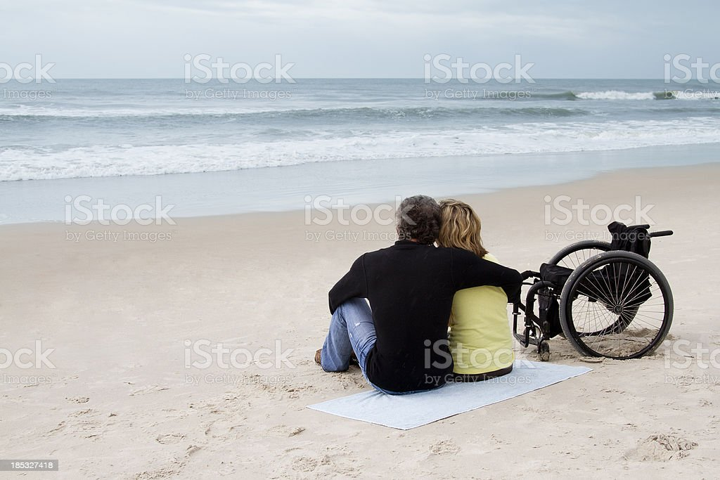 Couple at the Beach - with Wheelchair royalty-free stock photo