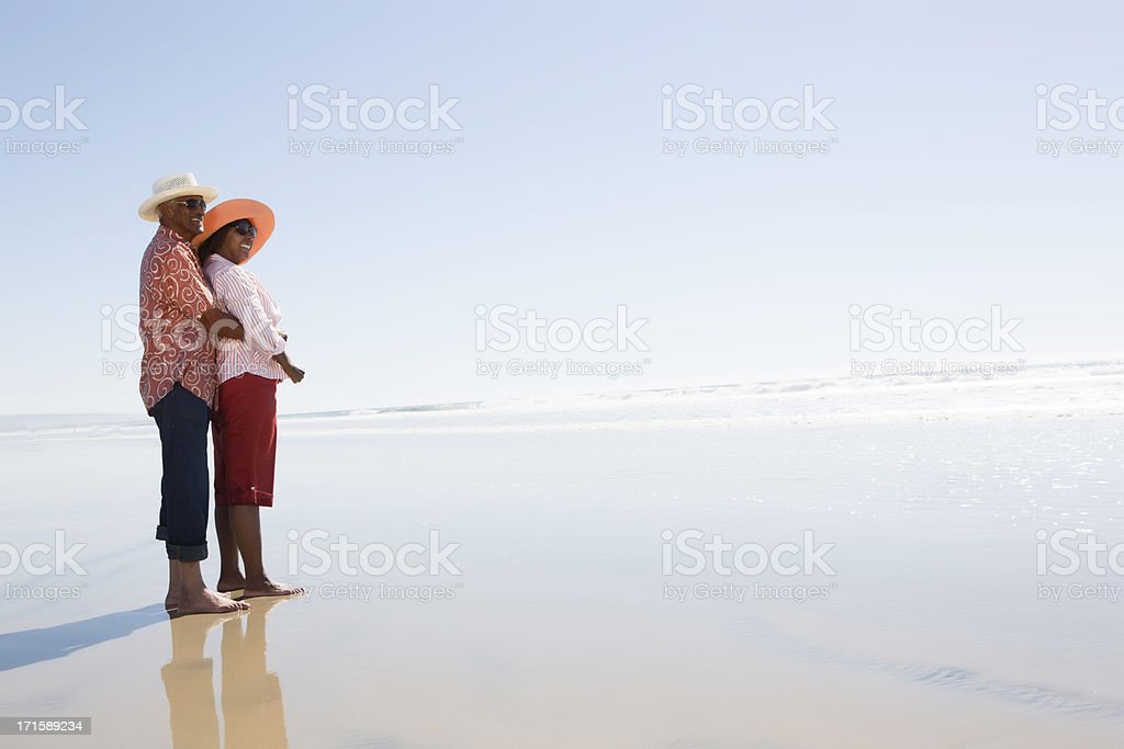 Couple at the ocean stock photo