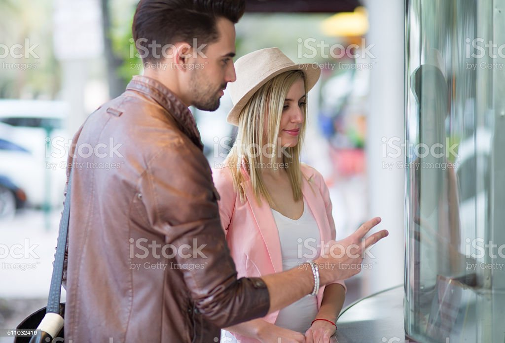 Couple at theater ticket booth stock photo