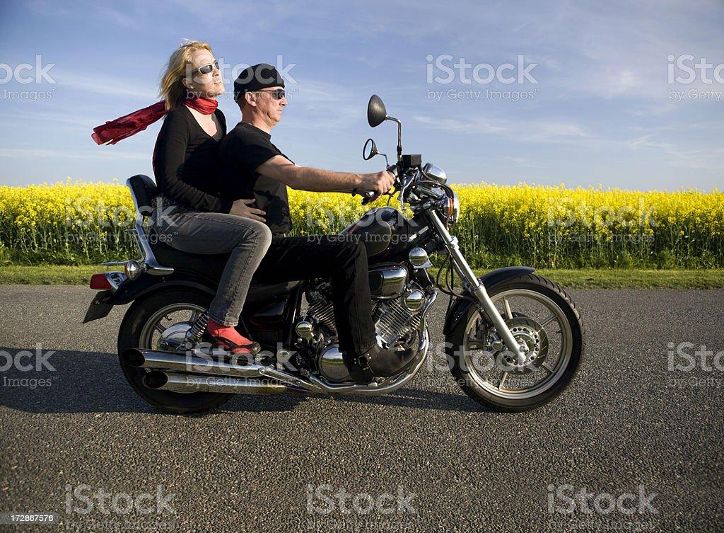 Couple at their bike royalty-free stock photo