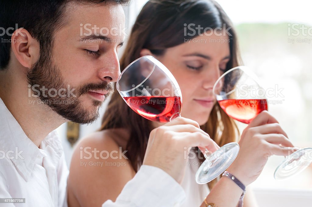 Couple at wine tasting. stock photo