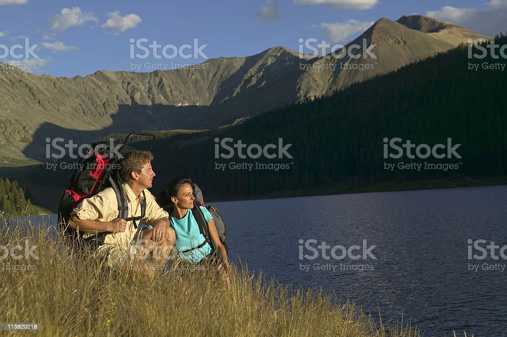 Couple Backpacking by Lake royalty-free stock photo