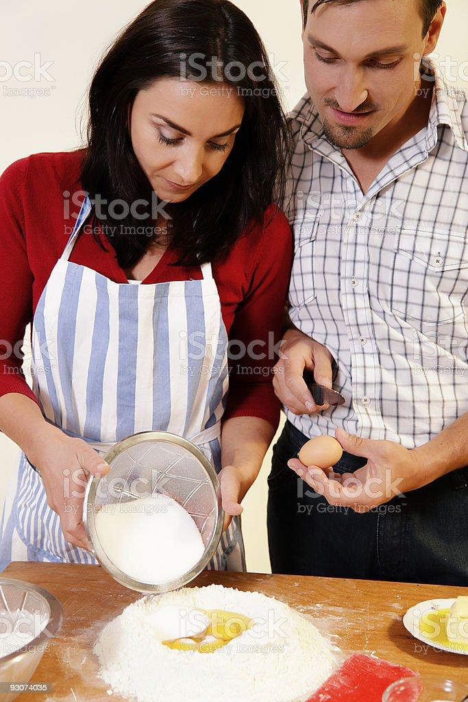 Couple baking together royalty-free stock photo