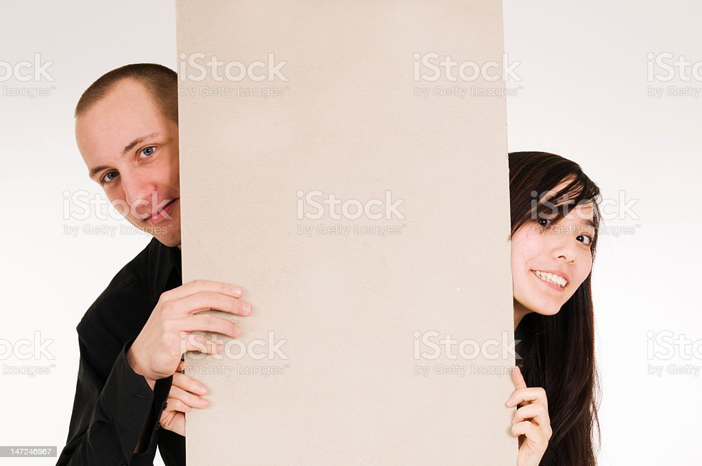couple behind board royalty-free stock photo