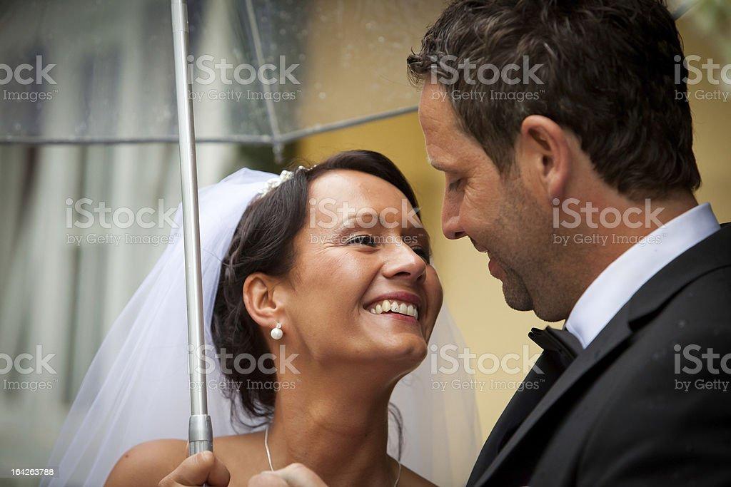 couple below umbrella stock photo