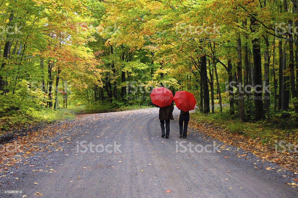 Couple beneath Red Umbrellas stock photo