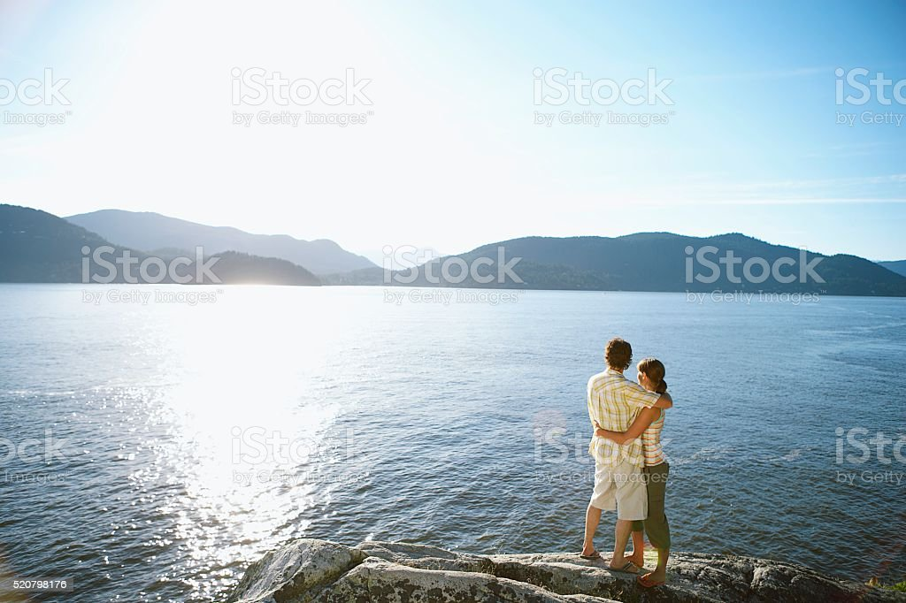 Couple beside a lake stock photo