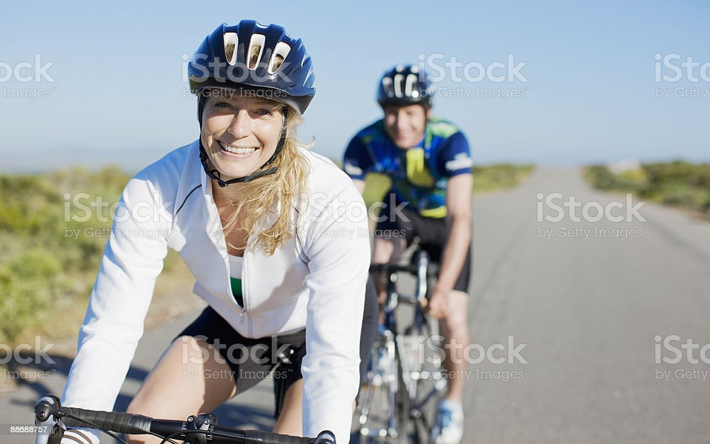 Couple bike riding in remote area stock photo