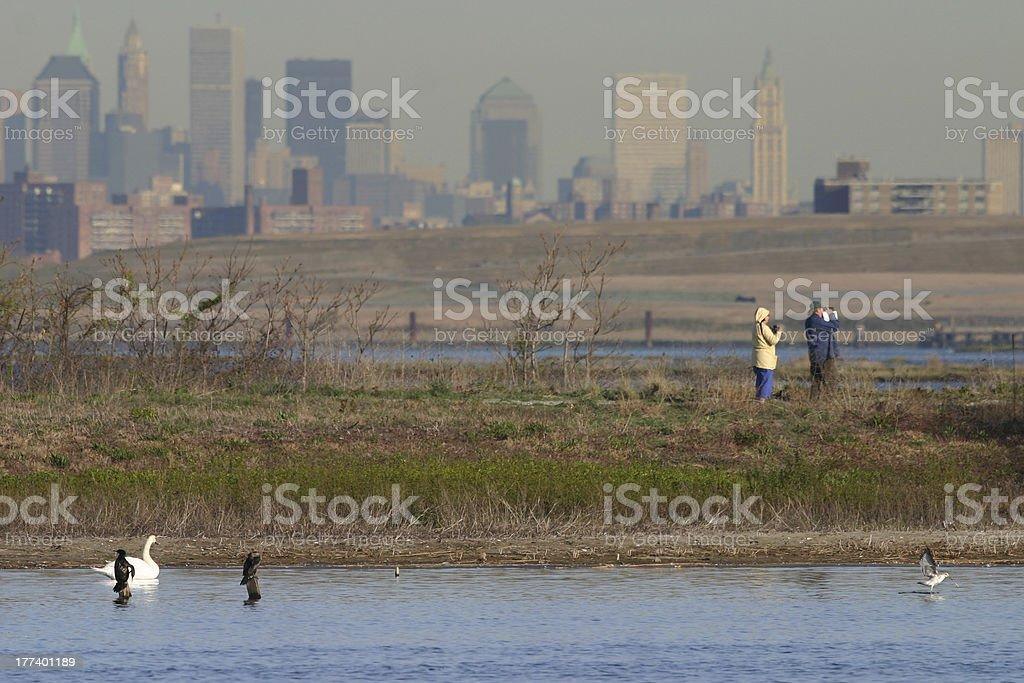 Couple birding in front of Manhattan skyline stock photo