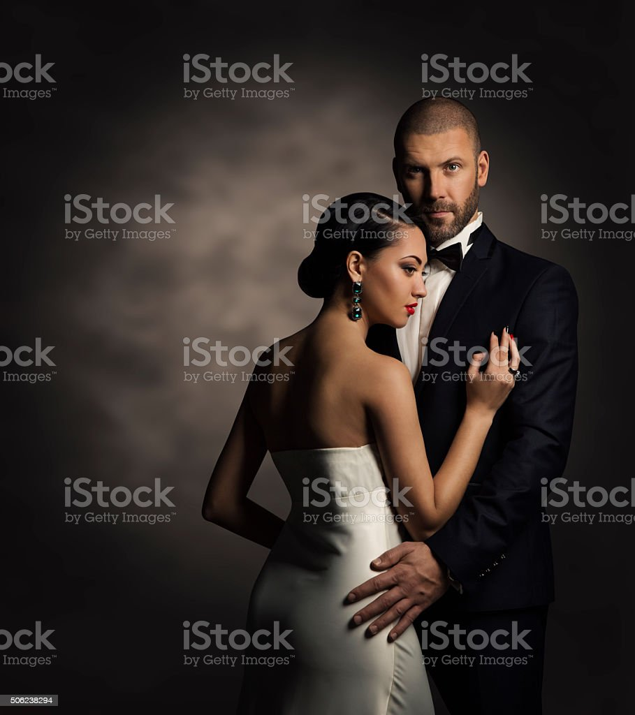 Couple Black Suit White Dress, Rich Man and Fashion Woman stock photo