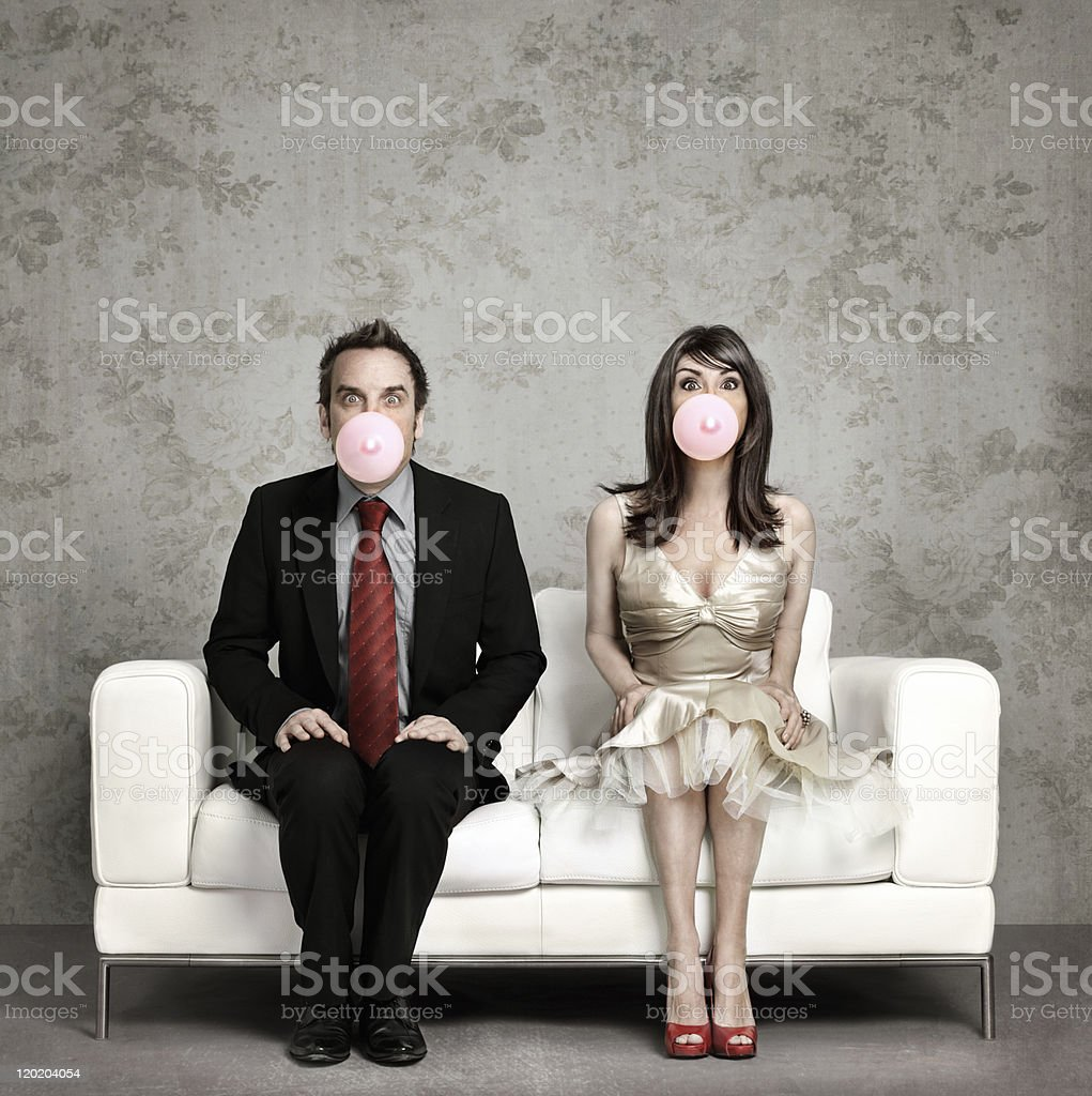 Couple blowing chewing gum stock photo