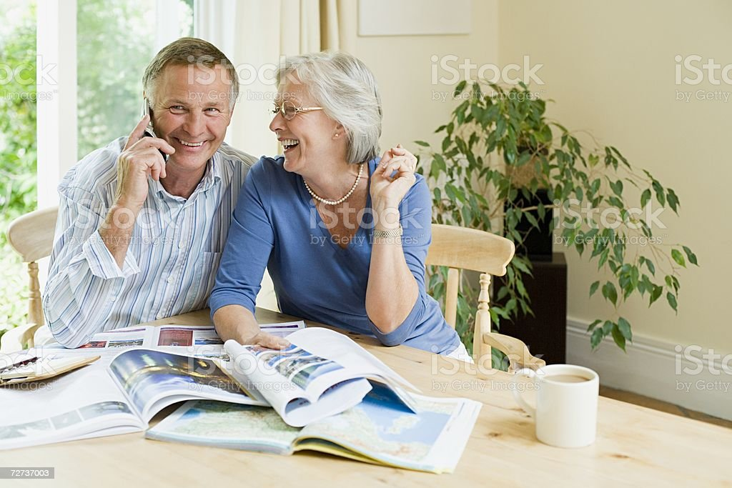 Couple booking a holiday stock photo