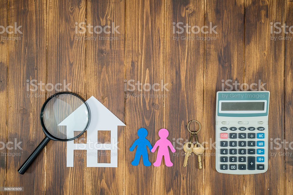 couple buy house Mortgage calculations, calculator with Magnifie stock photo