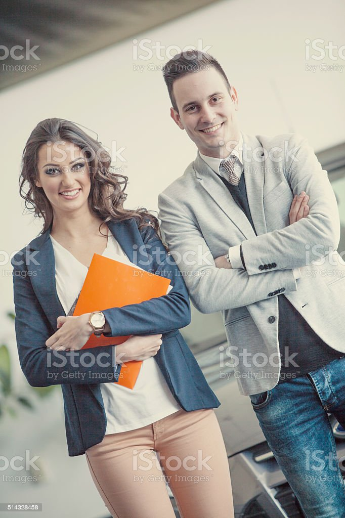 Couple buying a car stock photo