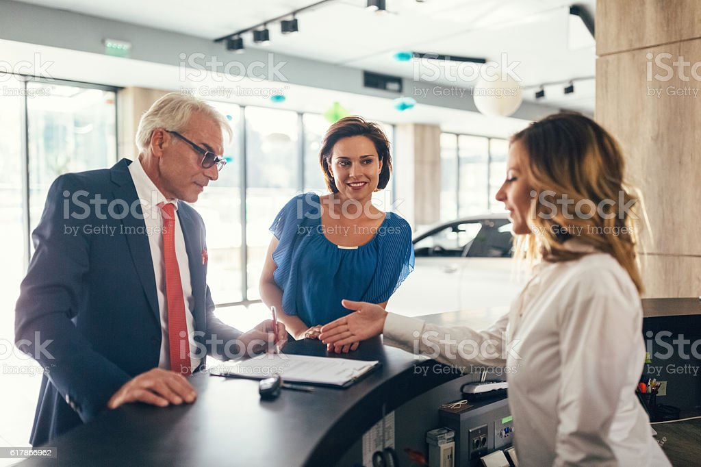 Couple buying a new car stock photo