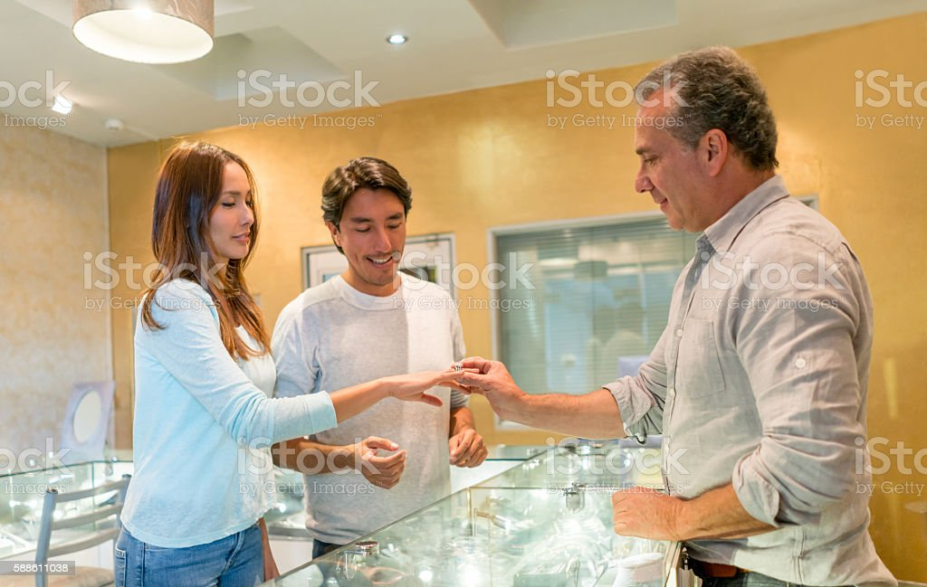 Couple buying an engagement ring stock photo