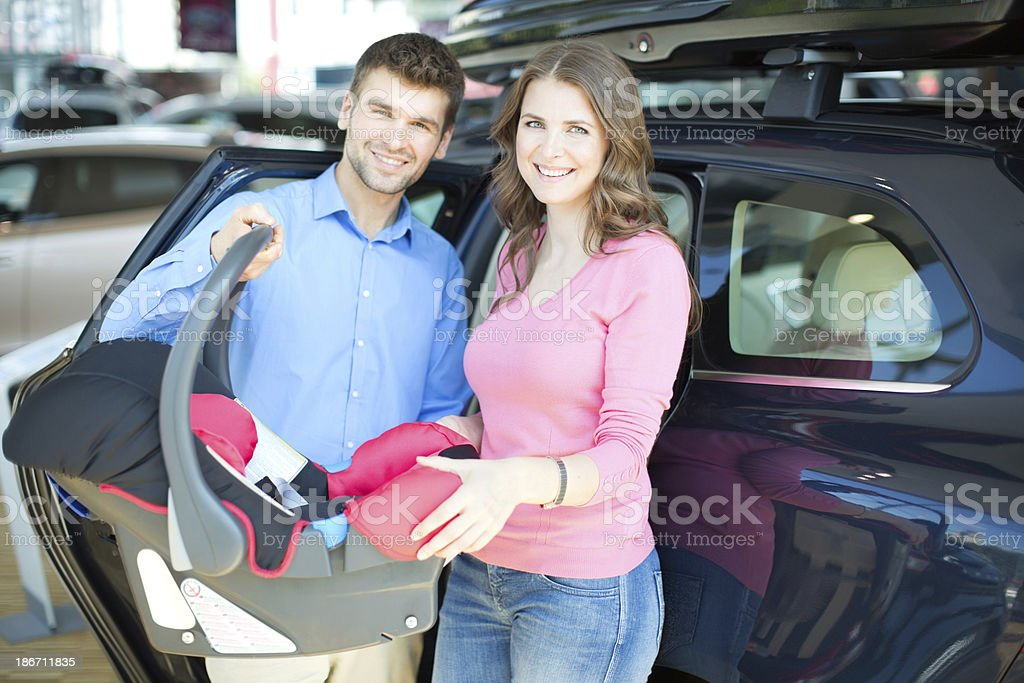 Couple buying baby car seat. royalty-free stock photo