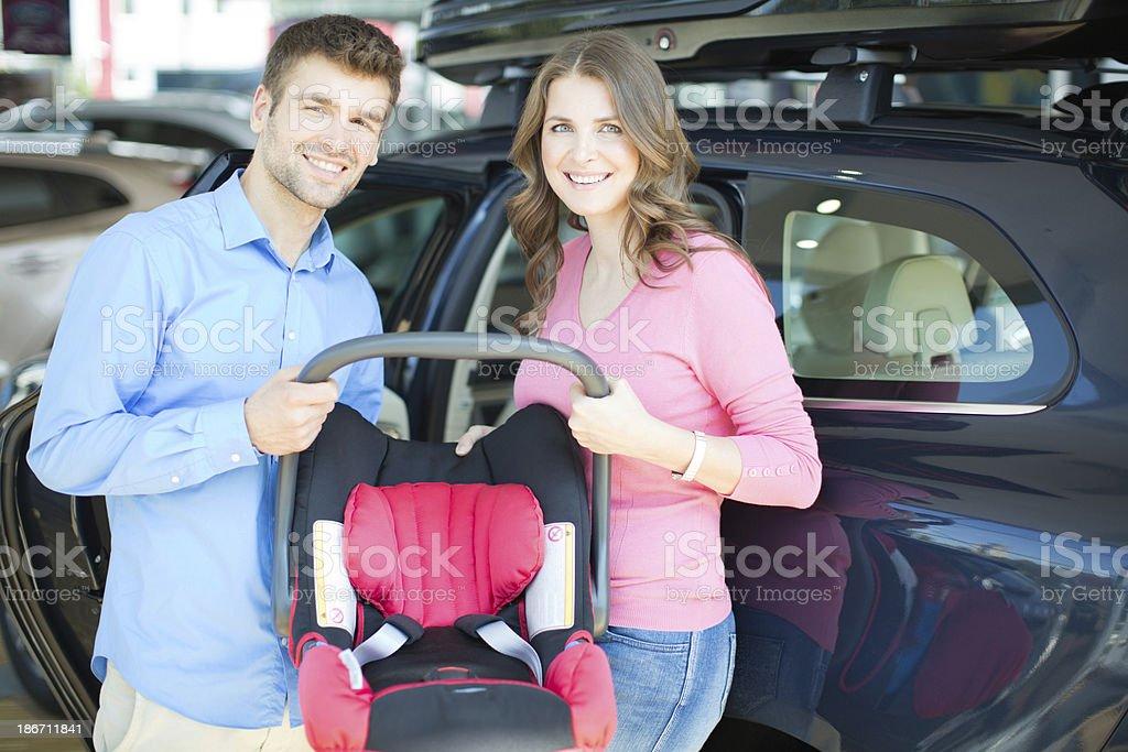 Couple buying baby car seat. royalty-free stock photo