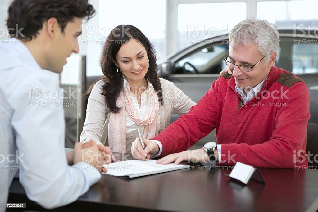 Couple buying car. stock photo