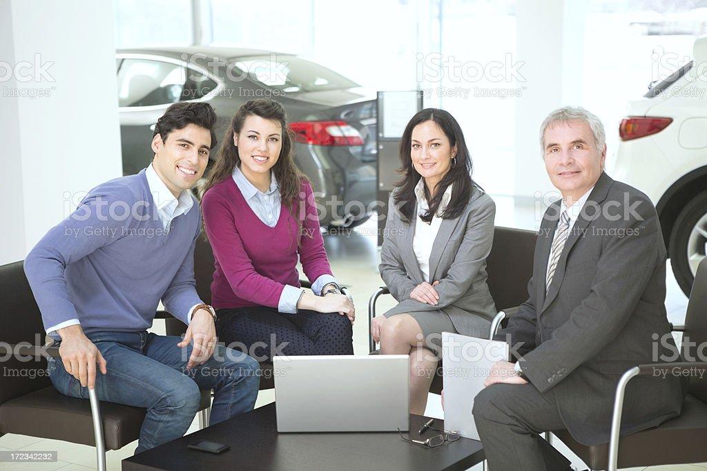 Couple buying car. royalty-free stock photo