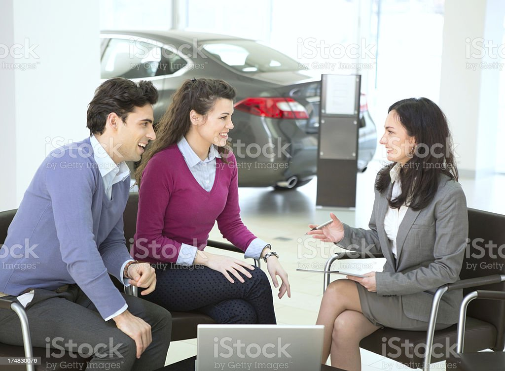 Couple buying car. royalty-free stock photo