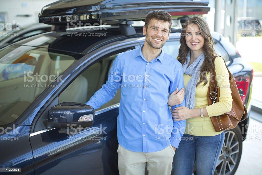 Couple buying car. stock photo