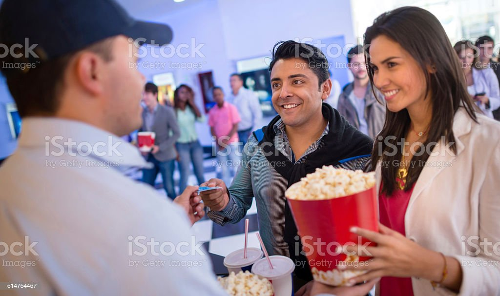 Couple buying food at the cinema stock photo