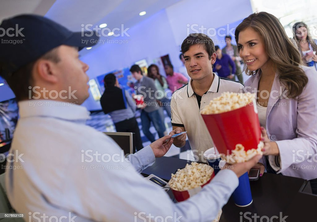 Couple buying food at the movies stock photo