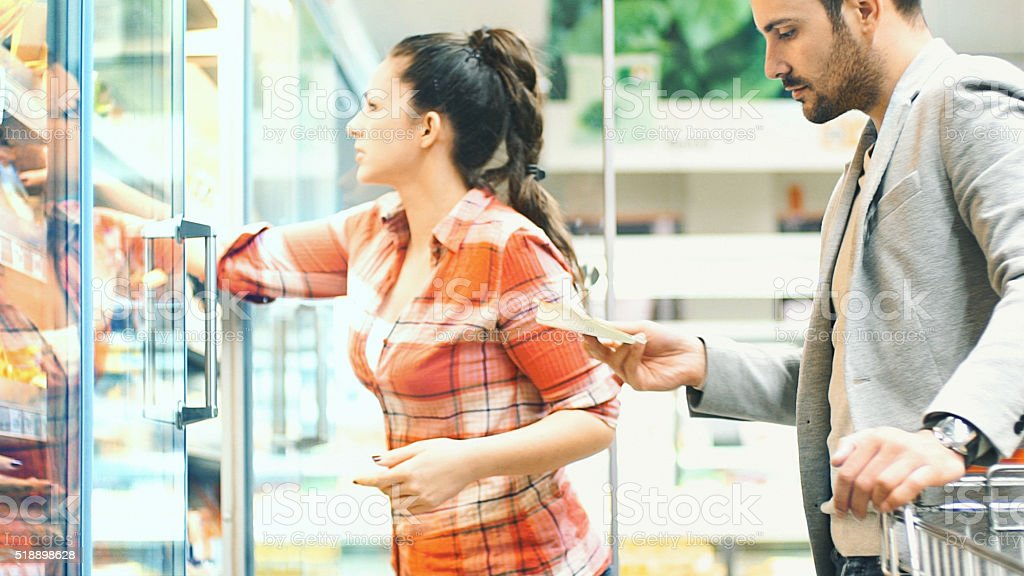 Couple buying food in supermarket. stock photo