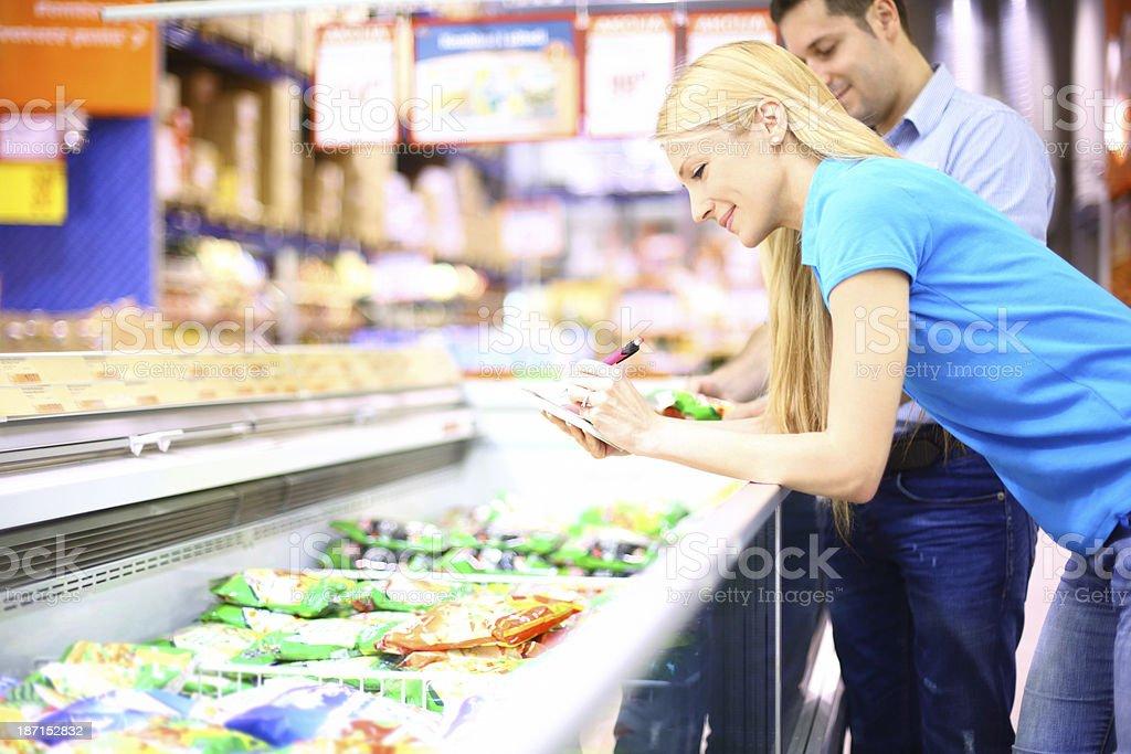 Couple buying frozen food. royalty-free stock photo