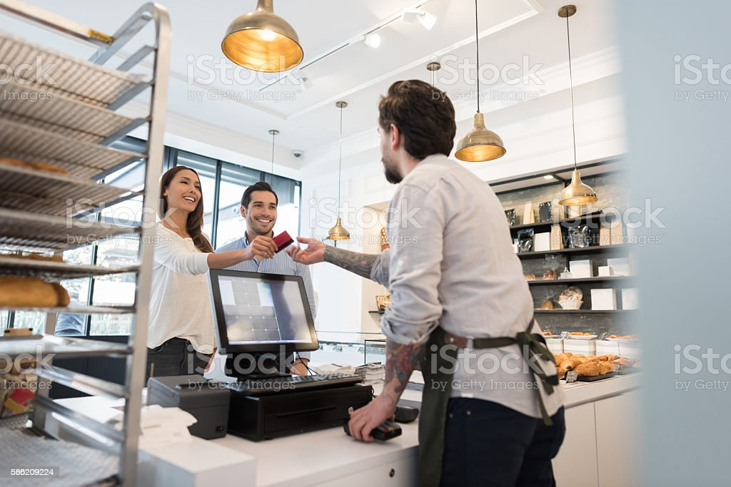 Couple buying goods at the bakery stock photo