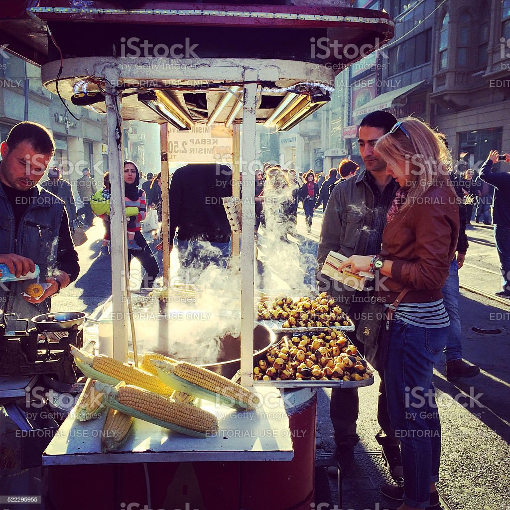 Couple buying grilled corn on Istiklal Avenue, Istanbul stock photo