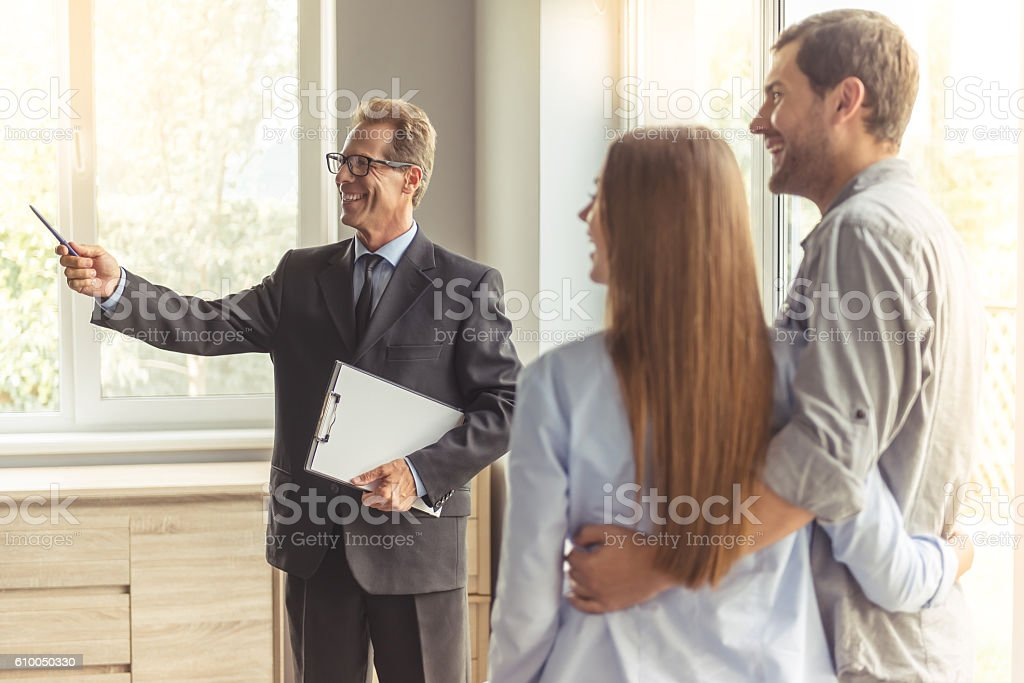 Couple buying new apartment stock photo