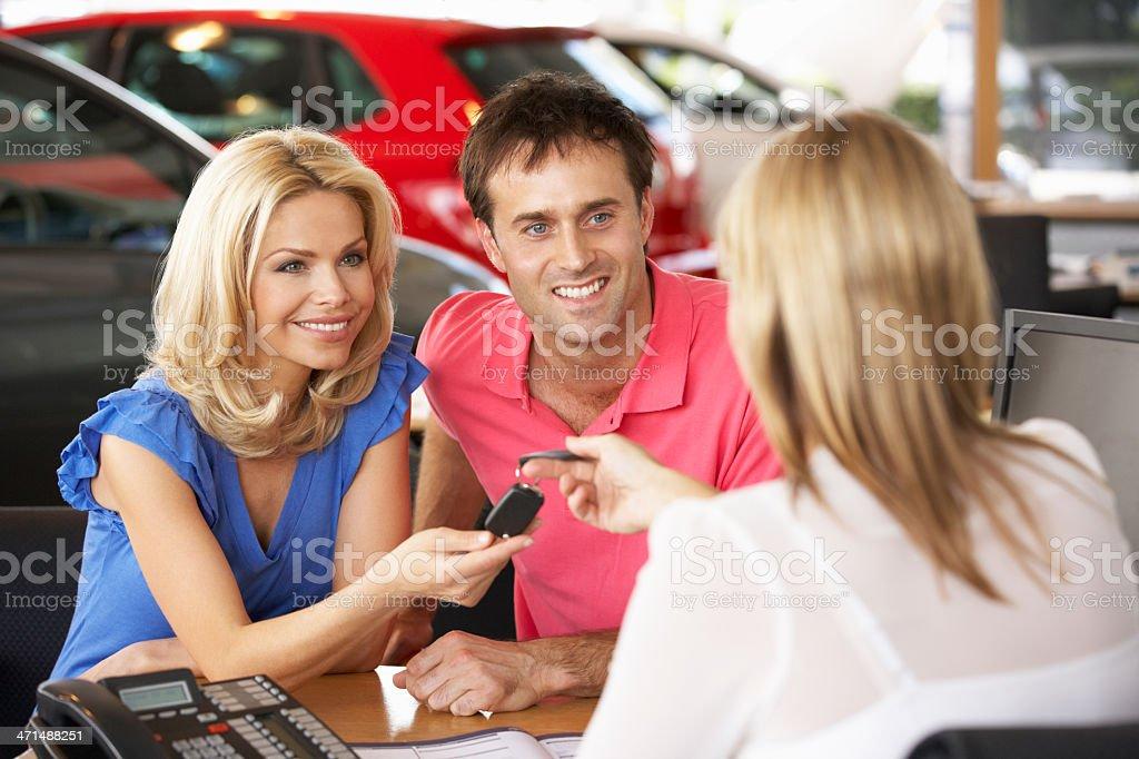 Couple buying new car royalty-free stock photo