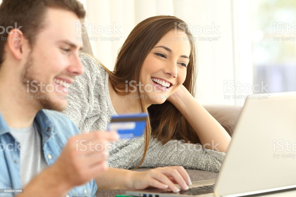 couple buying online on a couch stock photo 638892566 | istock