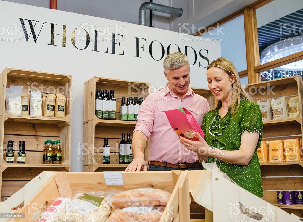 Couple Buying Whole Foods stock photo
