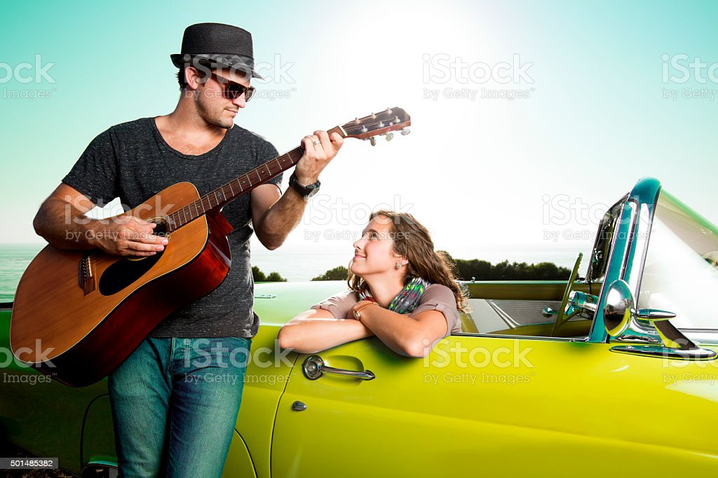 Couple by a Blue Convertible stock photo
