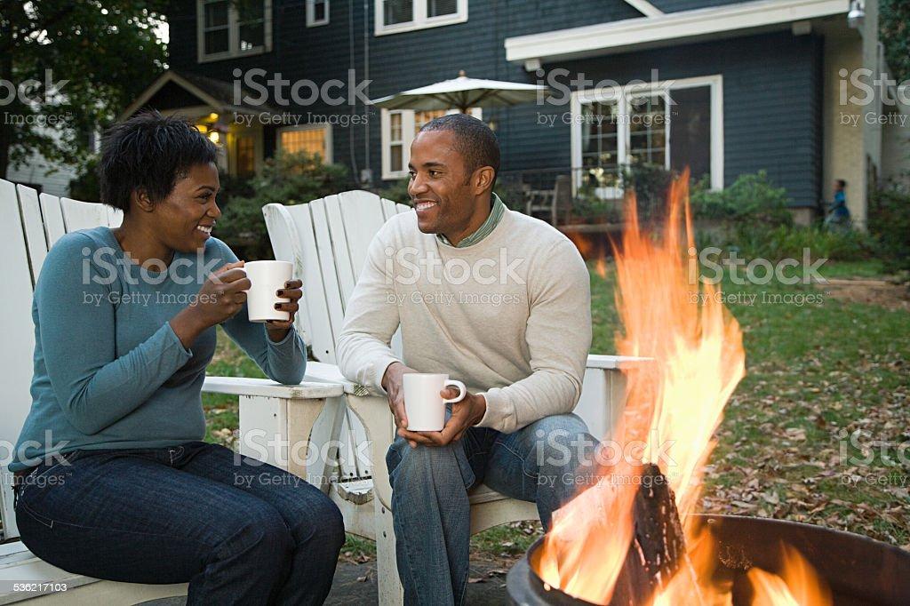 Couple by bonfire stock photo