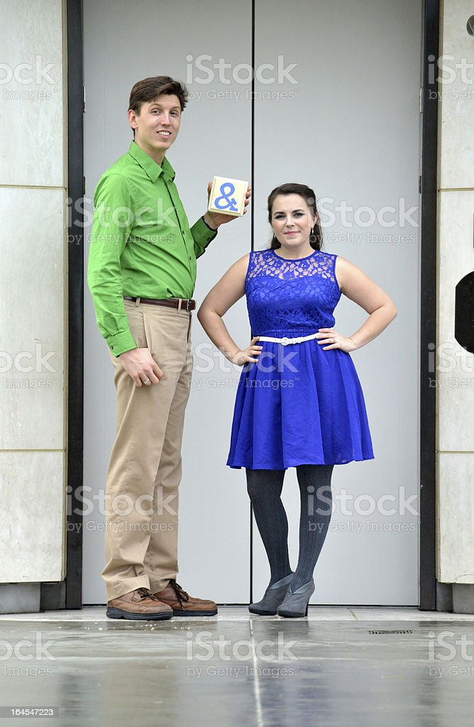 Couple by Elevator stock photo