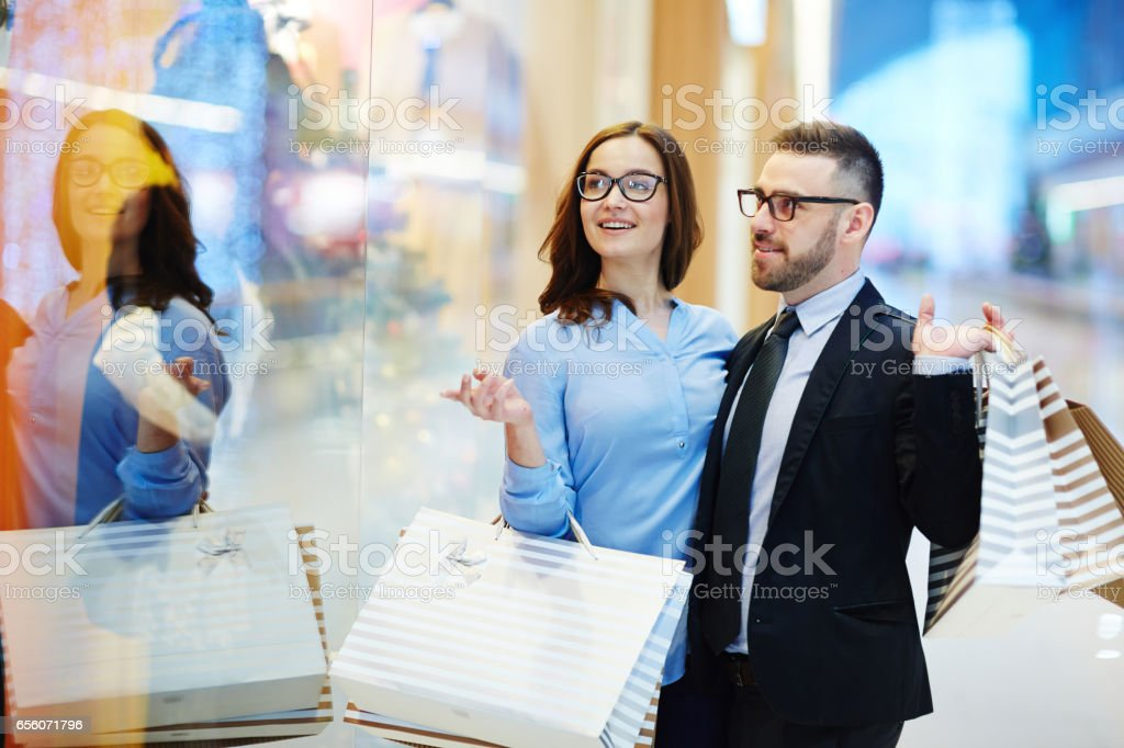 Couple by shop-window stock photo