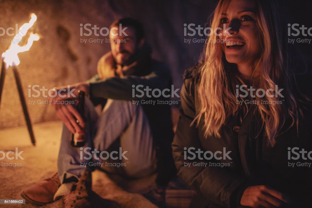 Couple by the campfire stock photo