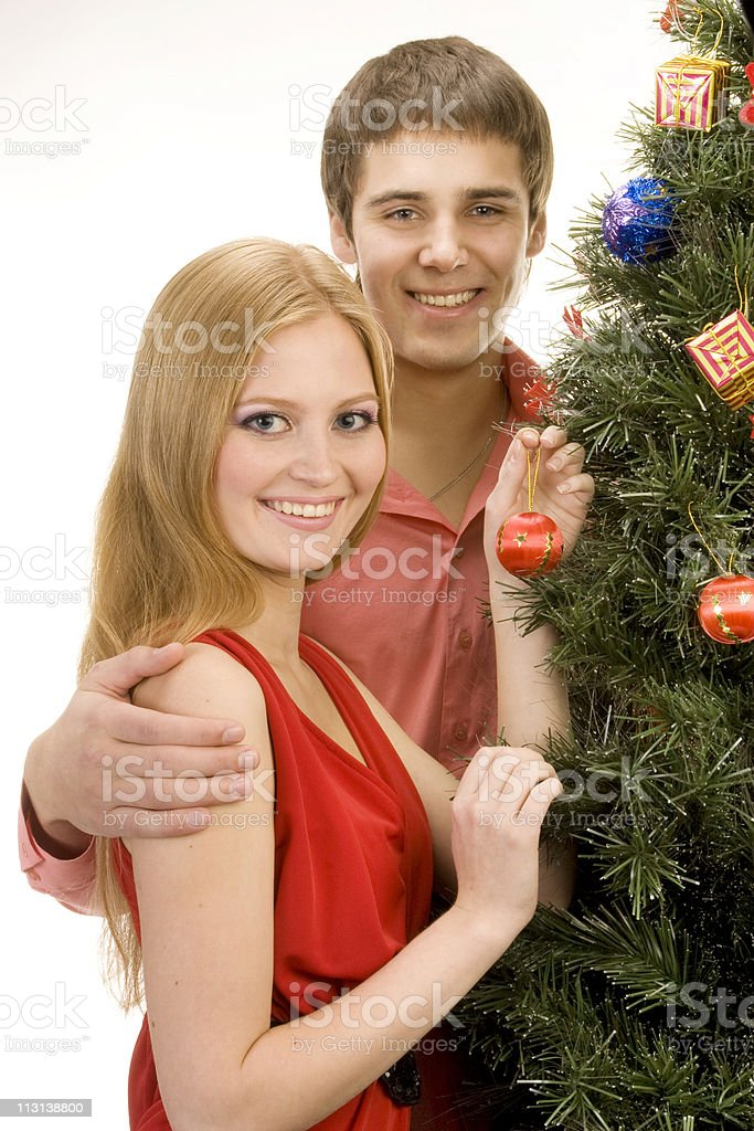 Couple by the christmas tree. royalty-free stock photo